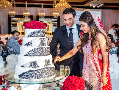 cutting cake at Indian wedding